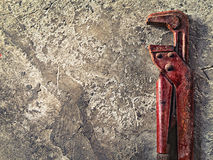 Old wrench on concrete Royalty Free Stock Image