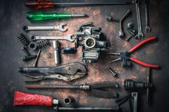 Old wrench and tools and carburetor on rusty background . moto. Rcycle tools and maintenance equipment and repair stock images