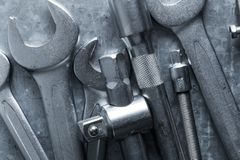 Old wrench and tools and Engine spare parts. On rusty background stock image