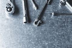 Old wrench and tools and Engine spare parts. On rusty background stock images