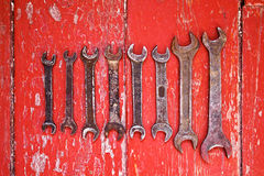 Old wrenches on the floor stained with red paint. Royalty Free Stock Image