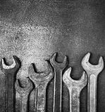 Old wrenches on a metal table Stock Images