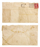 Old, Wrinkled Envelope. The front and back of a blank, envelope with frayed edges that is torn open at the top and heavily creased and wrinkled. Isolated on Stock Photography