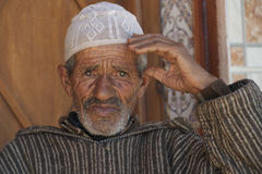 Old wrinkled man in Morocco. Very old poor but wise man in Morocco, raddled from life royalty free stock image