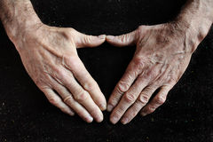 Old wrinkled hands Stock Photos