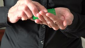 Old wrinkled hands of an elder woman taking her daily medications stock video