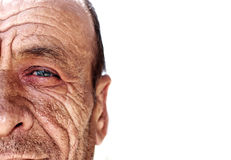 Old wrinkled man. Against white background Royalty Free Stock Image