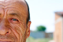Old wrinkled man. With blurry background Stock Image