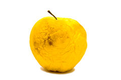 Old wrinkled yellowapple isolated Stock Photos