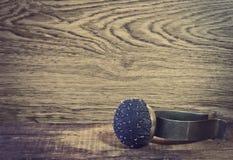 Old wrist pin cushion Stock Image