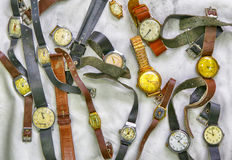 Old wrist watches, photo in old image style. Old Soviet-made wrist watches for men and women, photo in old image style Stock Photo