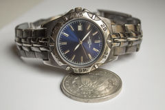 Old wrist watches and silver dollar. Stock Image