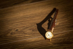 Old wristwatch with scratches on glass and leather strap Royalty Free Stock Photography