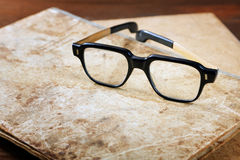 Old writing-books and glasses on a  table Stock Image
