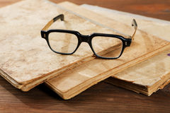 Old writing-books and glasses on  table Royalty Free Stock Image
