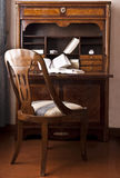 Old writing desk. With open books and chair Royalty Free Stock Image