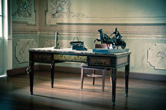 Old writing desk full of quills and typewriter Stock Photos