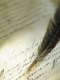 Old writing with a feather Stock Image