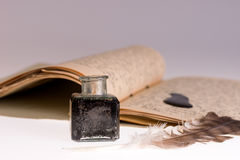 Old writing feather and ink spot with handwritten letter Royalty Free Stock Photos