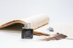 Old writing feather and ink spot with handwritten letter Royalty Free Stock Images