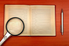Old Writing Pad And Loupe Stock Photography