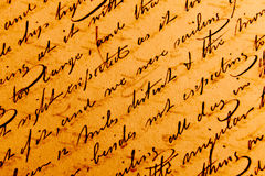 Old Writings. Close-up of script writing on a page inside an old open book. The writing on the other side of the page can be seen showing through Stock Images