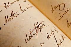 Old Writings - Mothers Day Background. Close-up of script writing on pages inside an old open book. Mothers Day Background. The key words are Mother, delightful Royalty Free Stock Photos