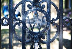 An old wrought iron gate with a design. stock images