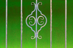 Old wrought-iron lattice on a green background stock photo