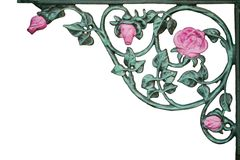 Old wrought iron pink rose vine bracket Royalty Free Stock Image