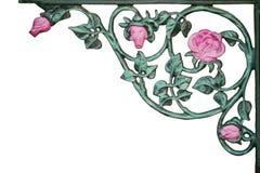 Old wrought iron pink rose vine bracket. Isolated old wrought iron pink rose vine bracket Royalty Free Stock Image