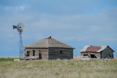 Old Wyoming Homestead. An old Wyoming homestead on the prairie. It stands after many years but age is showing stock photos