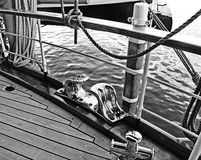 Old yacht, detail of deck with brass cleat Royalty Free Stock Photography