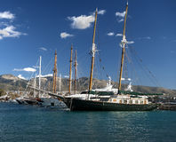 Old yacht on dock in athens Greece Stock Images