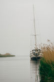 Old yacht in the fog Stock Photography