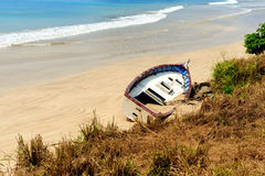 Old yacht stranded on a beach Royalty Free Stock Images