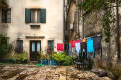 An old yard. Windows and doors. Croatia. Old Croatian courtyard. The laundry is dried on a rope royalty free stock image
