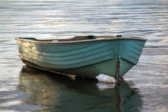 Old yawl boat floating Royalty Free Stock Images