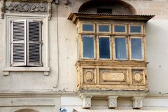 Old balcony and window in malta Royalty Free Stock Images