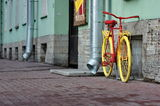 Old yellow bicycle Stock Photography