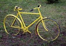 Old yellow bicycle. On the grass Royalty Free Stock Image