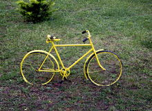 Old yellow bicycle. On the grass Royalty Free Stock Photography