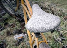 Old bike seat with hoar frost royalty free stock images
