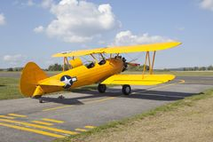 Old yellow biplane Stock Images