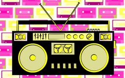 Old yellow and black retro vintage antique hipster obsolete cassette music audio tape recorder on a background of purple music aud Stock Photo