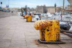 Old yellow bollard in the port Royalty Free Stock Photos