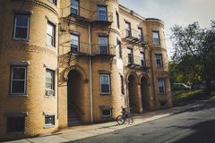 Old yellow brick house in North End, Boston. Old yellow brick house and a bicycle in North End district, Boston royalty free stock photo