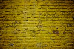 Old yellow brick wall Stock Images