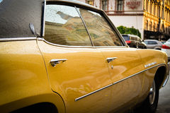 Old yellow Buick after rain. Odessa, Ukraine - July 15, 2015. Old yellow Buick after rain Royalty Free Stock Photo