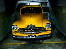 Old yellow Car. Old yellow FJ Holden parked in a garage stock photography